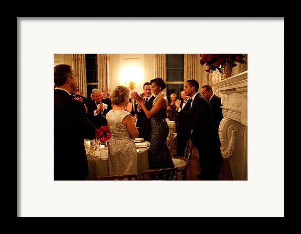 History Framed Print featuring the photograph President Obama Pulls Out The Chair by Everett