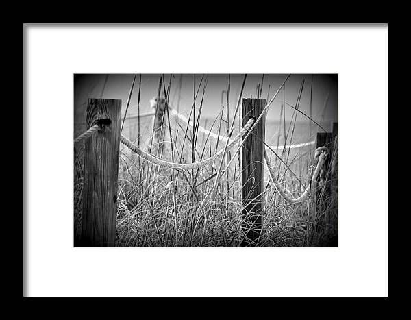Pylon Framed Print featuring the photograph Pylons On The Beach by Joe Freeman