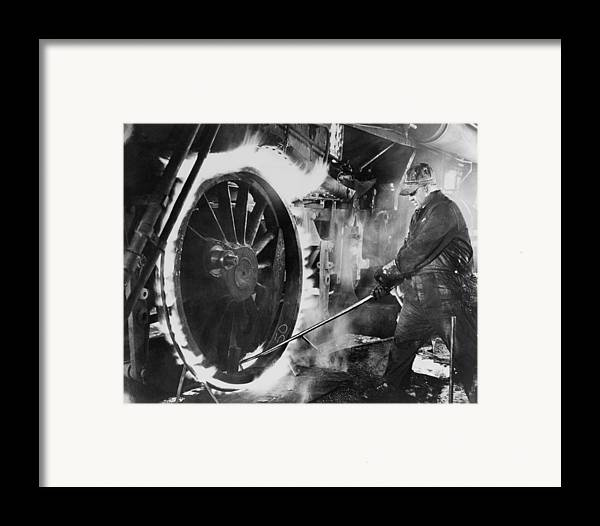 History Framed Print featuring the photograph Railroad Worker Sweating A Tire by Everett