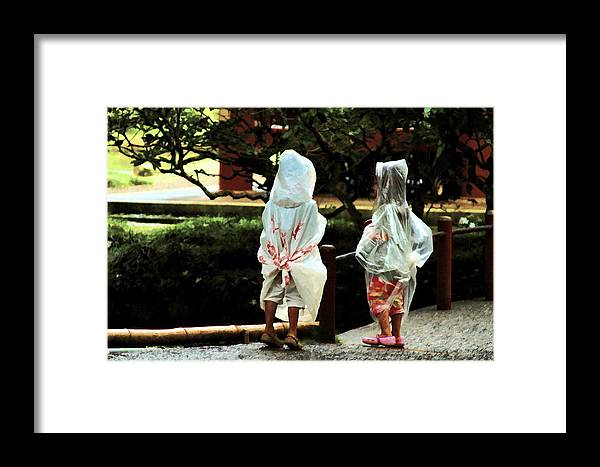 Children Framed Print featuring the photograph Rain Coats by Joel Lau