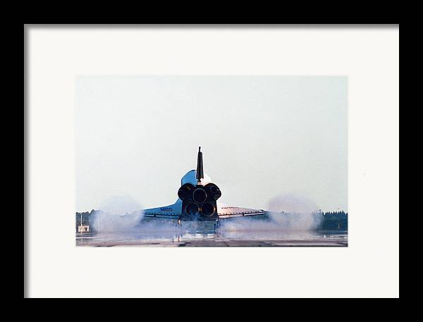 Horizontal Framed Print featuring the photograph Rear View Of The Landing Of The Space Shuttle by Stockbyte