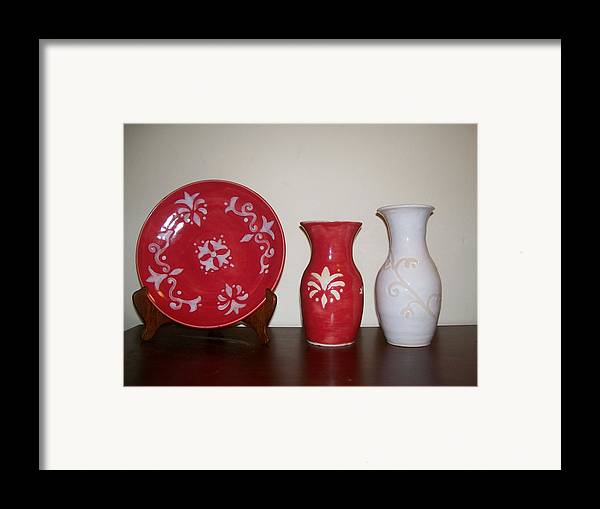 Red Framed Print featuring the ceramic art Red And White by Monika Hood