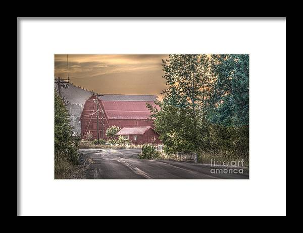 Kevin Felts Framed Print featuring the photograph Red Barn At The Curve by Kevin Felts
