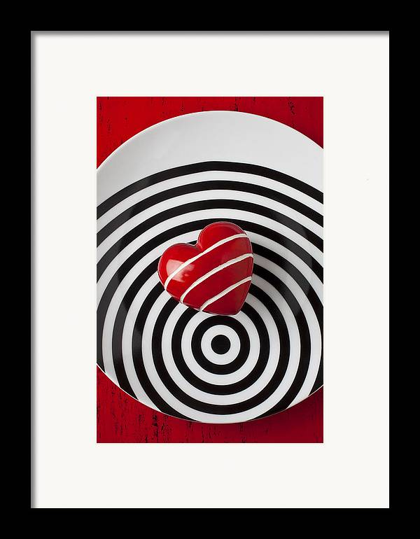 Red Framed Print featuring the photograph Red Heart On Circle Plate by Garry Gay