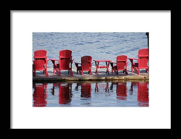 Muskoka Framed Print featuring the photograph Red Muskoka Chairs by Dr Carolyn Reinhart