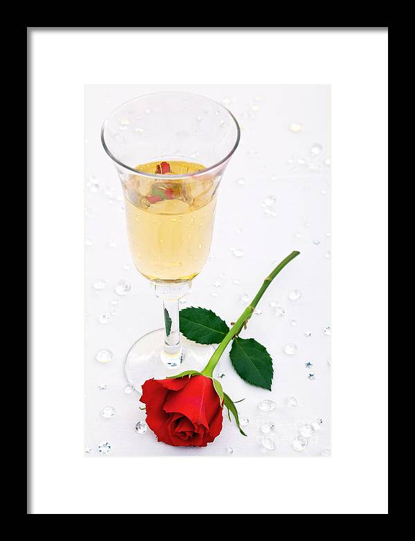 Red Framed Print featuring the photograph Red Rose And A Glass Of Champagne by Richard Thomas
