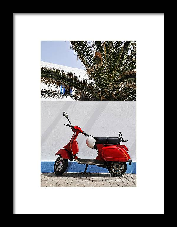 Simplicity Framed Print featuring the photograph Red Vespa By Wall by Sami Sarkis