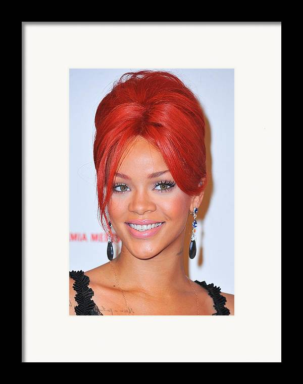 Rihanna Framed Print featuring the photograph Rihanna At A Public Appearance For Dkms by Everett