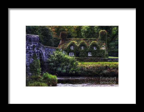 River Framed Print featuring the photograph River Cottage by Ian Mitchell