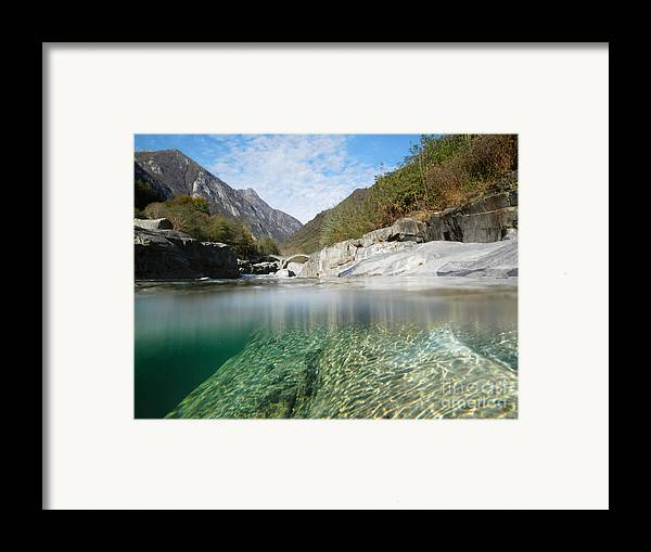 Under The Water Framed Print featuring the photograph River With A Roman Bridge by Mats Silvan
