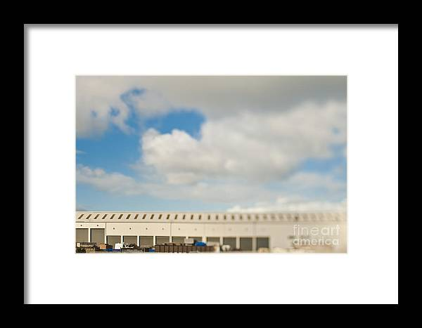Architecture Framed Print featuring the photograph Rolling Doors Of A Warehouse by Eddy Joaquim