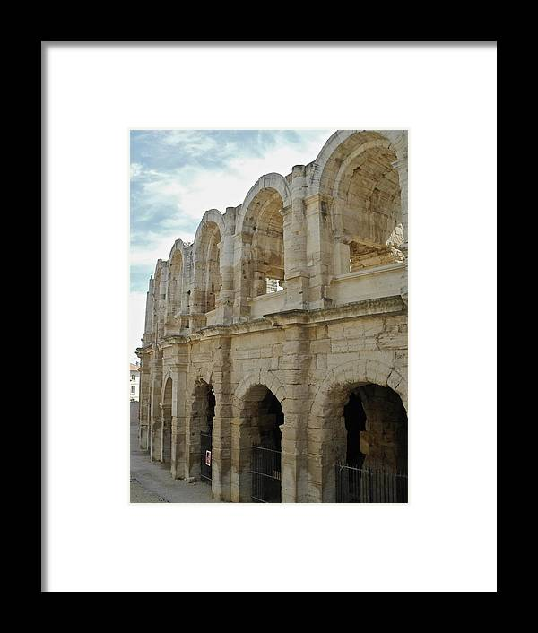 Roman Coliseum Framed Print featuring the photograph Roman Coliseum in Arles by Kirsten Giving
