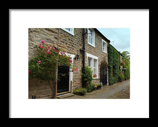Cottages Framed Print featuring the photograph Row Of Cottages. by Jacqui Kilcoyne