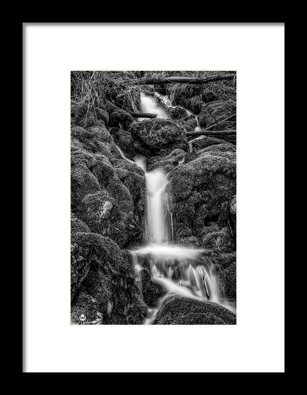 Black N White Framed Print featuring the photograph Running Through The Mossy Rocks Bw by Mitch Johanson