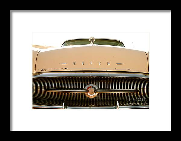 Car Framed Print featuring the photograph Rusted Antique Buick Car Brand Ornament by ELITE IMAGE photography By Chad McDermott