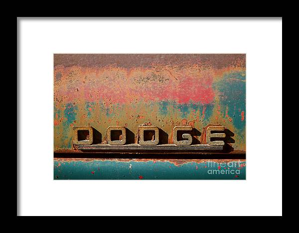 Car Framed Print featuring the photograph Rusted Antique Dodge Car Brand Ornament by ELITE IMAGE photography By Chad McDermott