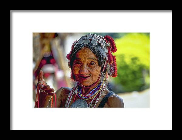 Book Framed Print featuring the photograph Saleswoman by Rudy Van Acker