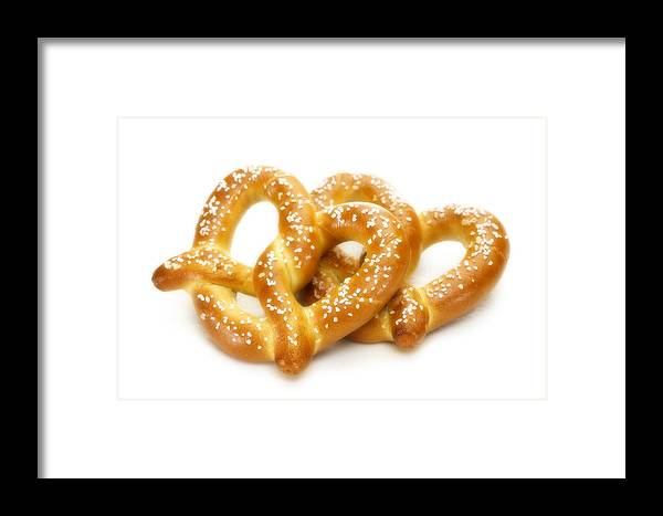 Pretzels Framed Print featuring the photograph Salted Pretzels by Federico Arce