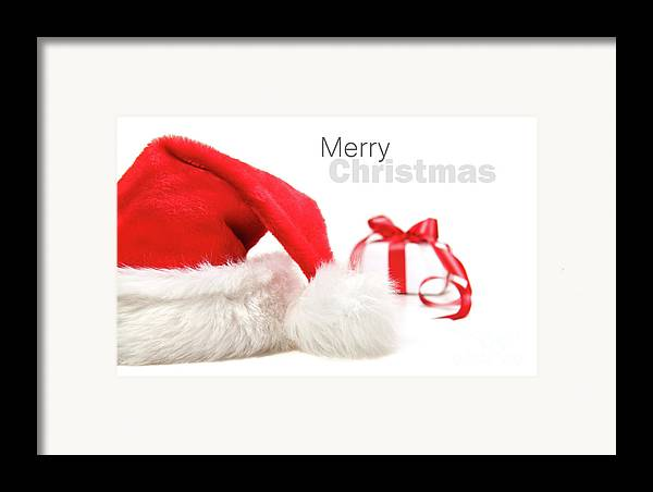 Cap Framed Print featuring the photograph Santa Hat And Gift With Red Bow by Sandra Cunningham