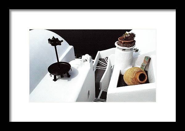 Santorini Framed Print featuring the photograph Santorini's rooftop abstract by John Banegas