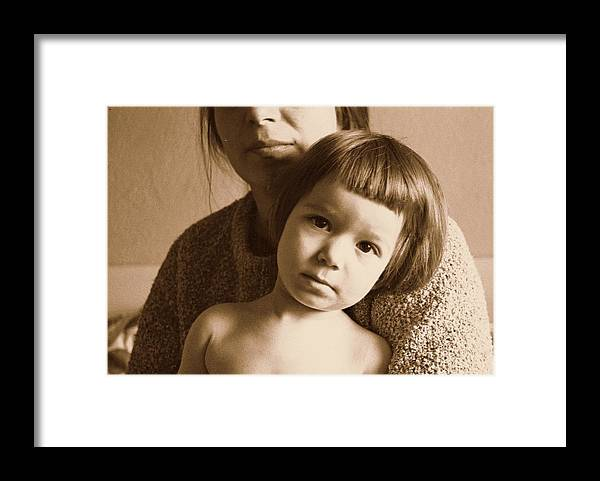 Art Framed Print featuring the photograph Secure In Mom's Arms by ITI Ion Vincent Danu