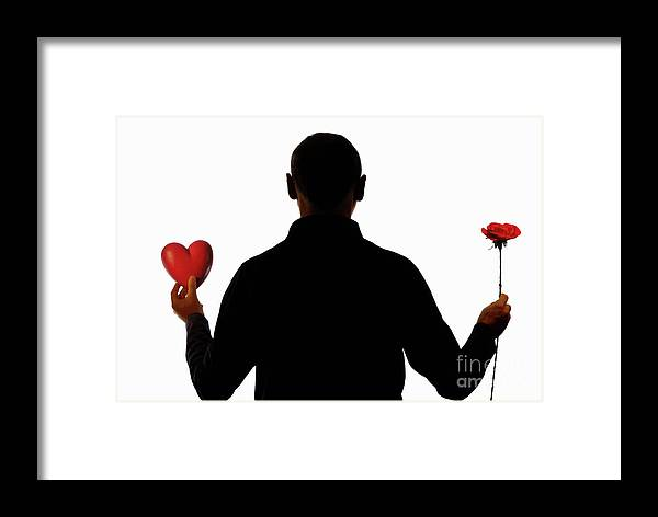 People Framed Print featuring the photograph Silhouette Of Man Holding Heart And Rose by Sami Sarkis