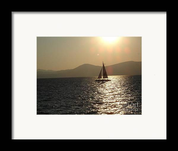 Landscape Framed Print featuring the photograph Single Sailboat by Silvie Kendall