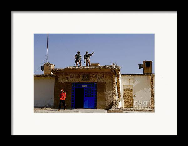 Atop Framed Print featuring the photograph Soldiers Discuss The New Iraqi Police by Stocktrek Images