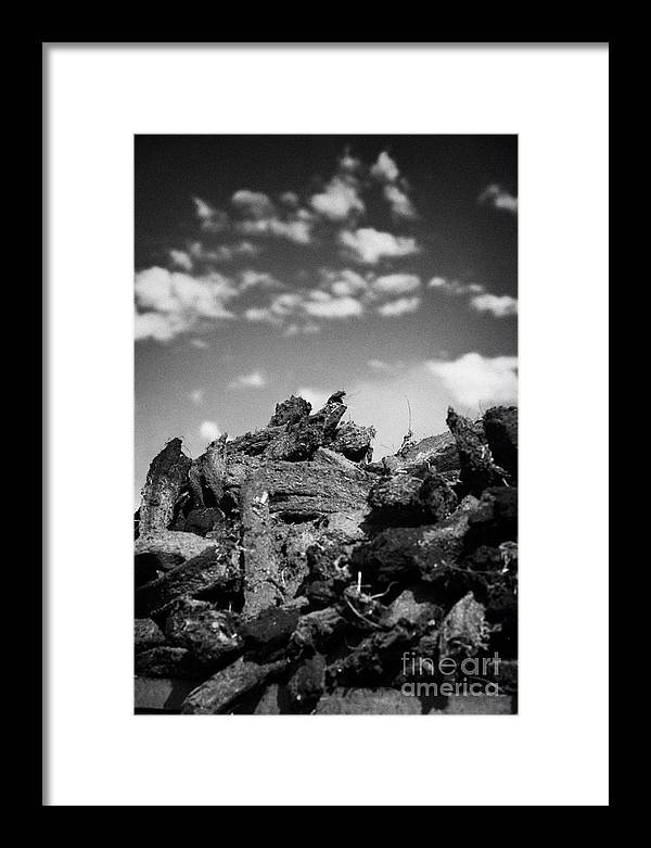 Republic Of Ireland Framed Print featuring the photograph Stack Of Peat Turf Gathered Dried In Ireland by Joe Fox