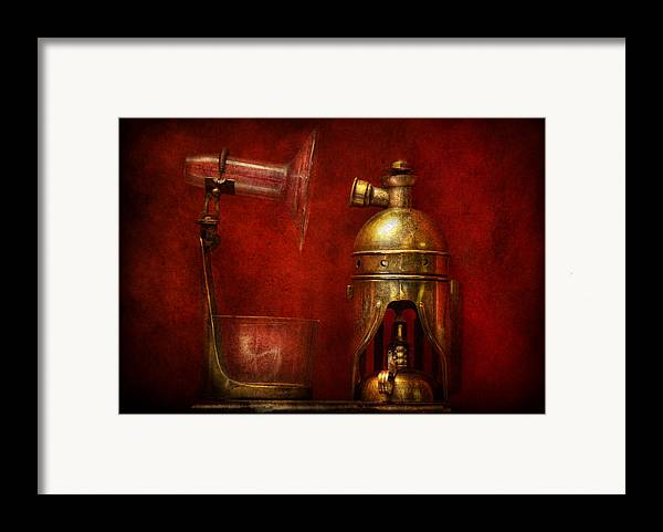 Torch Framed Print featuring the photograph Steampunk - The Torch by Mike Savad