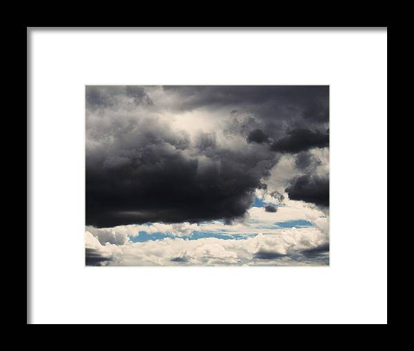 Storm Clouds Framed Print featuring the photograph Storm Clouds-1 by Todd Sherlock