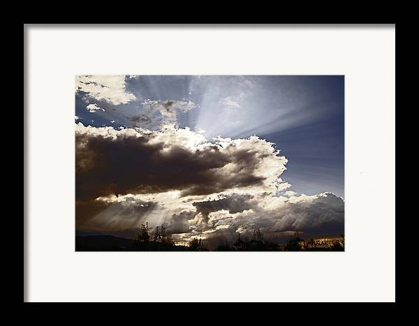 Sunlight Framed Print featuring the photograph Sunlight And Stormy Skies by Mick Anderson