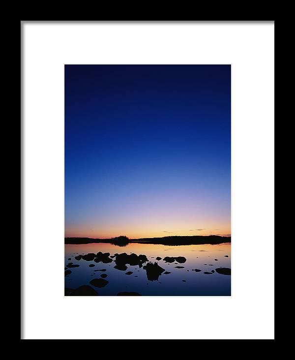 Dalecarlia Reservoir Framed Print featuring the photograph Sunset Over Bjorksjon by Mattias Klum
