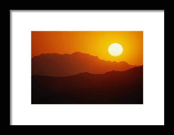 united States Framed Print featuring the photograph Sunset Over Silhouetted Mountain Ridges by Raymond Gehman