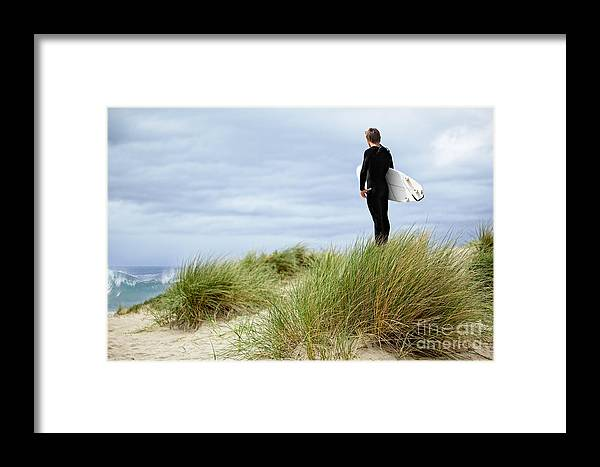 Active Framed Print featuring the photograph Surfer At The Beach Checking Out The Ocean Waves by Susan McKenzie