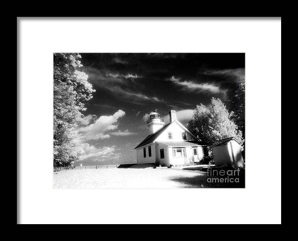 Infrared Prints Framed Print featuring the photograph Surreal Black White Infrared Black Sky Lighthouse - Traverse City Michigan Mission Point Lighthouse by Kathy Fornal