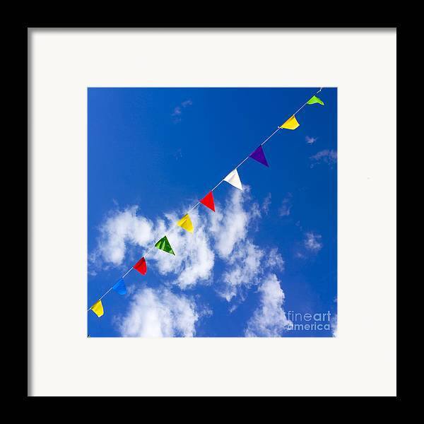 Little Flag Framed Print featuring the photograph Suspended Festive Flags. by Bernard Jaubert