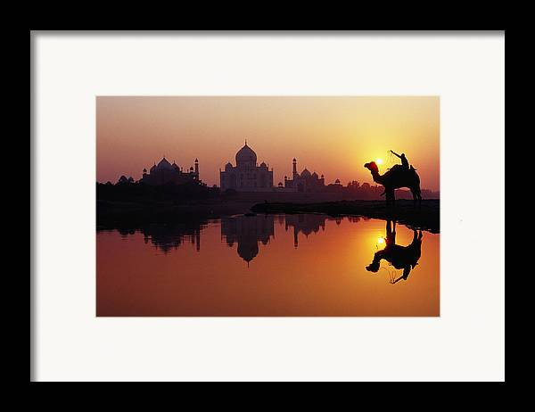 Horizontal Framed Print featuring the photograph Taj Mahal & Silhouetted Camel & Reflection In Yamuna River At Sunset by Richard I'Anson