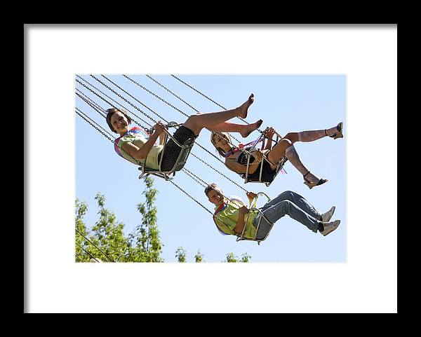 Carousel Framed Print featuring the photograph Teenagers On Fairground Ride by Ria Novosti