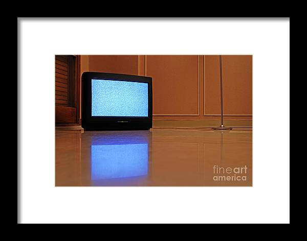 Reflective Framed Print featuring the photograph Television Displaying Static Reflected In Floor by Sami Sarkis