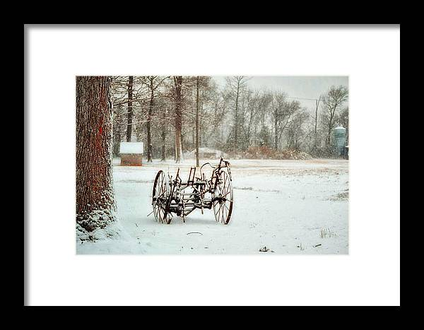 Snow Framed Print featuring the photograph The Broken Wheel by Kelly Reber