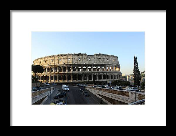 Rome Framed Print featuring the photograph The Colosseum in Rome by Munir Alawi