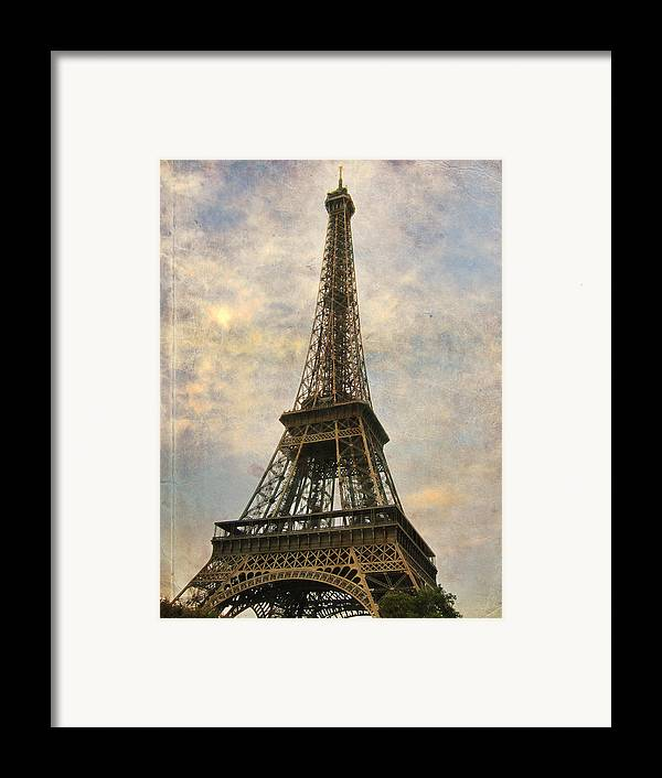 The Eiffel Tower Framed Print featuring the photograph The Eiffel Tower by Laurie Search