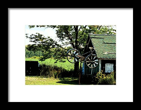 The Old Bike Shoppe Framed Print featuring the photograph The Old Bike Shoppe by Cyryn Fyrcyd