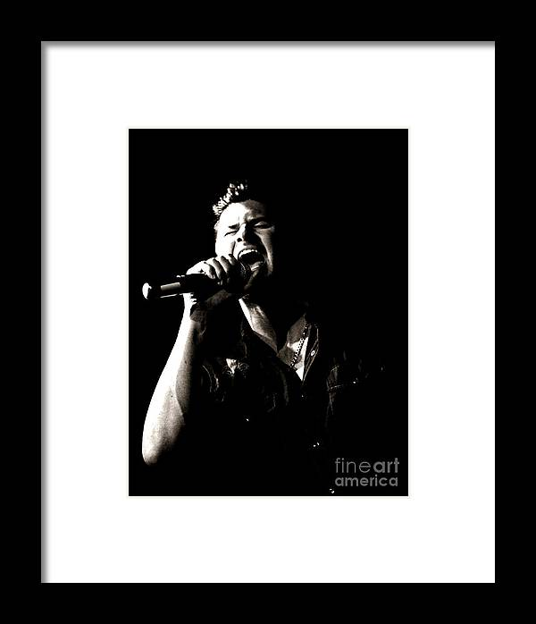 Sing Framed Print featuring the photograph The Singer by James Yang