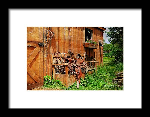 Western Saddle Framed Print featuring the photograph The Western Saddle by Paul Ward