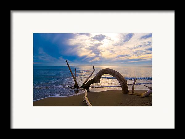 Driftwood Sea Mediterranean Sunset Sky Cloud Water Calm Serenity Framed Print featuring the photograph The Wooden Arch by Marco Busoni