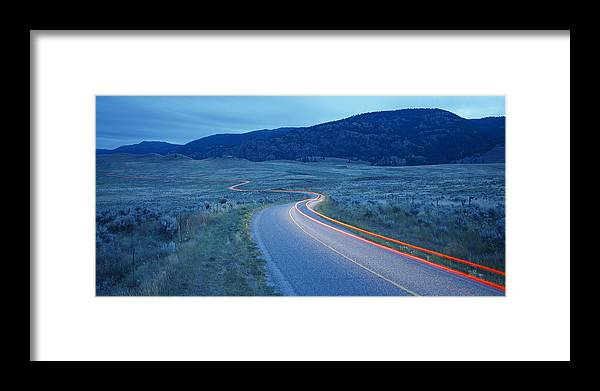 Traffic Framed Print featuring the photograph Traffic At Dusk by David Nunuk