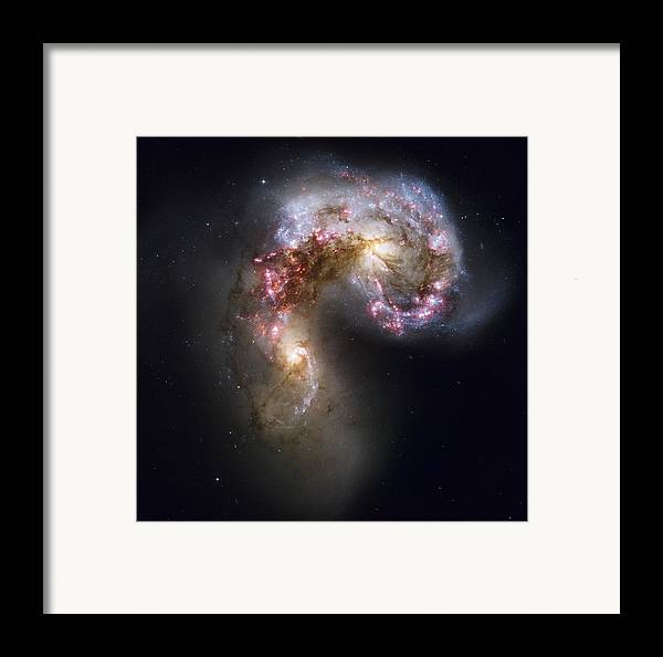 Galaxy Framed Print featuring the photograph Trailing Streamers Of Gas And Stars by ESA and nASA