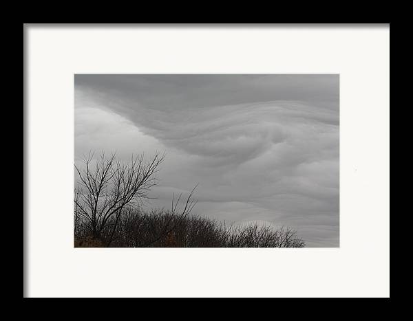 Turbulent Skies Framed Print featuring the photograph Turbulent Sky by Deb Kline